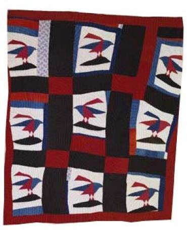 Whether the owner, Blanche Ransom Coleman Parker, made this quilt is unclear. What is clear is the dynamic impact of the quilt's composition: bold color, and the sense of birds in flight. Blanche Parker was a skilled seamstress and devoted educator first in Carroll County, Tennessee and then in Missouri. In 1938 she came back to Carroll County as a Jeanes Supervisor, an African-American teacher chosen by individual southern county school superintendents for teaching and leadership skills. After her death in