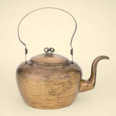 Dovetailed construction and the hammered surface of burnished copper define this graceful Philadelphia teakettle, made in about 1800.