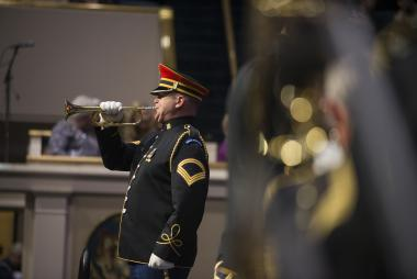 The bugler calls for the Opening Night procession to begin.