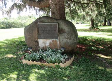 """In 1909, members of the Catherine Schuyler chapter placed this plaque on a boulder marking the site of the Caneadea Council House (Iroquois nation), and in particular, the place where Revolutionary War patriot Major Moses VanCampen ran the """"gauntlet""""."""