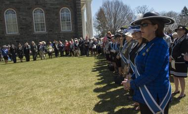 The large crowd, including many of the DAR Executive Board, gathers outside the Old Cadet Chapel for the wreath laying at the Margaret Corbin Monument.