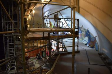 In this image you can see the set-up of how the artisans worked on the mural in the dome above the Constitution Hall stage.