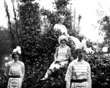 """In 1928, queens of the Tournament of Roses were not school girls but were women of distinction in the community. Harriet Sterling was chosen to represent America in the 1928 parade where the theme was """"States and Nations in Flowers."""" She wore a many-pronged crown as """"America Enthroned."""" Harriet Sterling, a high school teacher was at the time Regent of the Martin Severance Chapter of the Daughters of the American Revolution. Sterling later was a member of the Board of Education."""