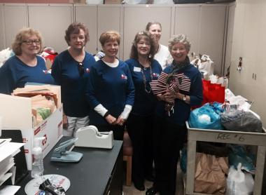 The Massey Harbison/ Fort Hand Chapter in New Kensington, PA gathered 140 bags of specific non-perishable food items to be given to veterans leaving the VA Hospital. Each bag contained a can of chicken, a can of Spam, a can of tuna, a jar of peanut butter, a jar of jelly, 3 ramen noodle soups, 2 cans of fruit cocktail, a roll of toilet paper, and a small American flag. A group of our Daughters delivered the bags to the VA facility in Aspinwall , PA. While there, we ran into another group of Daughters from