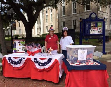 Today Bartow Chapter (Florida), DAR celebrated the Day of Service for DAR's 125th anniversary by collecting retired American flags from citizens, businesses and members.    We joined our community's Antique Fair and set up in front of our wonderful Polk County History Center pictured in the background.    Flags were taken to our local American Legion for proper disposal.