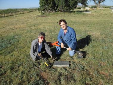 Tucumcari Chapter, Tucumcari, New Mexico members Gwen Gray and Wanda Evans at Quay Cemetery. Cleaned the weeds and grass around grave marker for Civil War Veteran, Abijah Keith. Other members worked at the Tucumcari Historical Museum cleaning out the Christmas shed.