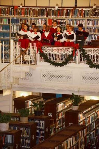 Performers from Adventure Theatre, a youth performance group, provided music in the Library balcony.
