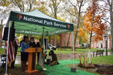 DAR First Vice President General Denise VanBuren speaking next to one of DAR's trees in Independence National Historical Park.