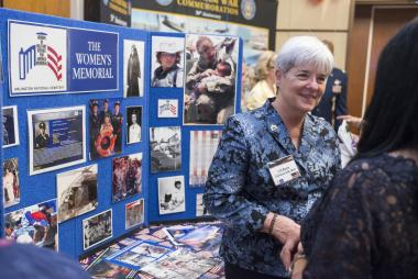 Various DAR committees and outside organizations had information booths at Celebrate America Night sharing opportunities for members to become involved in their local communities. LTC Marilla Cushman, USA (Ret) of the Women in Military Service for America Memorial (WIMSA) shared information about the organization's efforts. WIMSA was founded by DAR member Brigadier General Wilma Vaught.