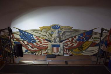 The flag mural in the dome of Constitution Hall is actually painted on canvas adhered directly to the plaster of the dome and cornice with adhesive and small tacks.
