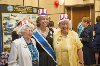 President General Lynn Young has a playful moment posing with Brigadier General Wilma Vaught of WIMSA and a DAR member.