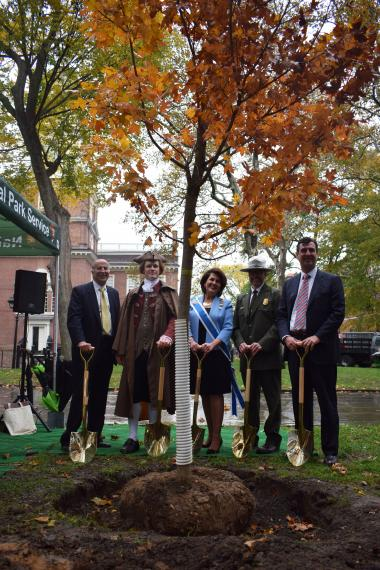 Mark Squilla, Philadelphia City Councilmember; Thomas Jefferson, principal author of the Declaration of Independence and 3rd President of the United States;  Denise Doring VanBuren, DAR First Vice President General; Patrick Suddath, Acting Superintendent of Independence National Historical Park; Andrew Hohns, USA250 Board Chair – standing with one of the 76 trees DAR will sponsor in Independence National Historical Park.