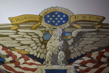 A close up look at the flag mural where you can see the dividing line down the eagle showing where the right side has been cleaned and the left side is still in need of cleaning from the dirt and other elements had built up over the years.