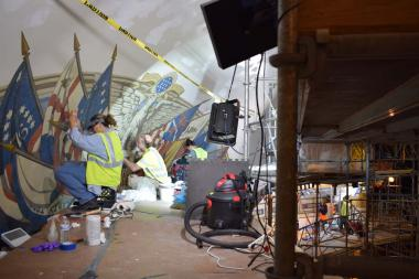 Here you can see work being done on the canvas mural paintings on two levels of the scaffolding – the flag mural in the dome and the state names in the cornice below the dome.