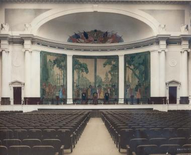 When the DAR Constitution Hall auditorium first opened in 1929, it featured a pale palette that highlighted the colorful canvas flag mural in the dome above the stage and a decorative four-panel curtain painted with historic American Revolution era scenes.