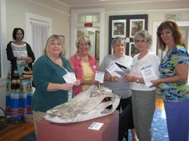 Grant Recipient, Education Category: Seminole County Historical Society Sanford, Fla. Members of sponsoring Sallie Harrison Chapter and museum personnel hold some of the 500 new labels purchased for the Museum of Seminole County History. The new labels contain information pertinent to each exhibit to enhance the educational experience of visitors.