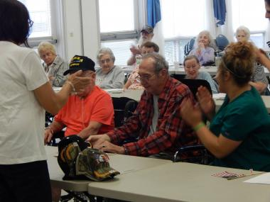 The Fort Augusta Chapter, PA, held a Veterans Service Day at their local nursing home. They thanked the veterans for their service and had music and snacks.