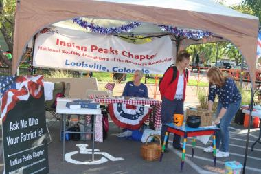The Indian Peaks Chapter, CO, hosted a booth at their local Oktoberfest where children created cards for veterans and they showed people how to use the DAR's Genealogical Research System (GRS).