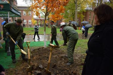 National Park Service rangers assist with the final grunt work of planting the DAR tree.