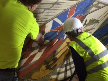 President General Dillon getting an update on the flag mural conservation.