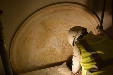 Years of built up paint was removed on the medallions before they were painted again, to help enhance their features.