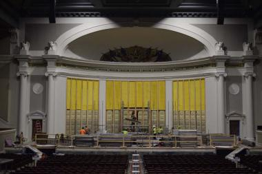 The yellow and egg carton looking material along the wall of the stage is special acoustic treatment to help enhance the sounds in Constitution Hall during shows.