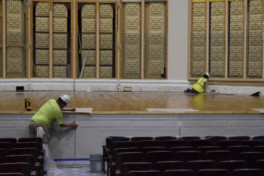 The stage apron (the part extended into the seating area) was, for the most part, returned to its original design aesthetic, but instead of using plaster, as the original design had called for, hardy glass fiber reinforced gypsum (GFRG) was used to create the panels.