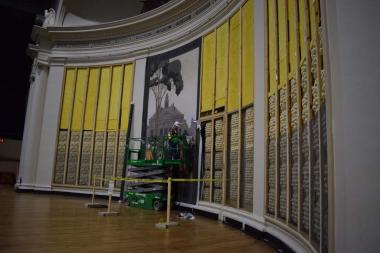 Producing replicas of the original 1929 painted curtains would not be practical. So instead, an artist recreated scaled down versions of the original scenes, the paintings were then scanned and the four scenes were scaled to fit each 16 foot wide acoustic panel, printed, and then meticulously installed by being stretched over the acoustic paneling on the back of stage wall.