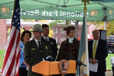 Acting Superintendent of Independence National Historical Park Patrick Suddath welcomed those to the tree planting ceremony, thanking DAR for the gift and joked that the rainy weather of the day would be perfect for the newly planted trees.