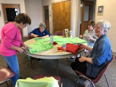 The Ann Rogers Clark Chapter made lap blankets for local veterans in assisted living homes & women veterans