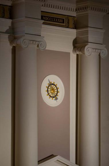 The medallions were given a specialty detailed painting and gilding to make them stand out from the neutral paint tones around the rest of the stage.