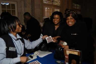 January 27, 2005 – U.S. Postal Service staff selling ceremony collectibles and first day of issue cancellations to philatelists in the Pennsylvania Foyer of DAR Headquarters.