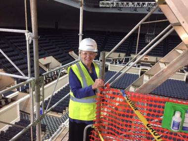 President General Ann Dillon climbs the scaffolding for inspection of the work. She has said that getting to see a close up view of the decorative features of the Constitution Hall at 40 feet above the stage has been one of the highlights of serving as President General.