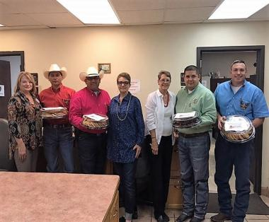 Atascosa Chapter, TX present local police and fire departments with trays of cookies, cases of bottled water and Gatorade, in appreciation for their service.