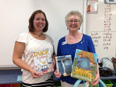 The Fox River Valley Chapter, IL was invited to participate in their local elementary school's reading night by reading books aloud to the group