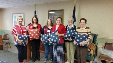 Fort Augusta Chapter, PA volunteered at their local assisted living facility by presenting pillows to veteran residents and thanked them for their service