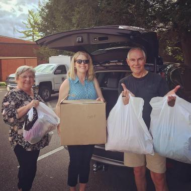 The Old Glory Chapter brought donations to Bridges Domestic Violence Center.