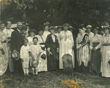 DC Daughters, prior to 1915, at one of the DC Boundary Markers, originally placed in 1792. This photo was taken prior to the placement of the iron enclosure. ( the lady in the striped dress looks like Mary S. Lockwood)