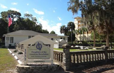 The historic first cemetery in Sarasota County Florida is that of Sarasota's first settlers William and Mary Whitaker and their descendants. The first burial took place in 1879. The Sara De Soto chapter was deeded the cemetery in 1939 by the family which it continues to maintain and assist with Whitaker family funerals. Photo of cemetery and chapter house.