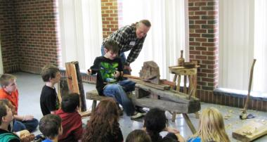 Terry Ratliff is a craftsman who was also part of the Visiting Artist Series. Mr. Ratliff makes chairs, tables, stools, benches and mantelpieces for a living. He showed students how to use a maul, a drawing horse, froe and adze to make ladder-back chairs.