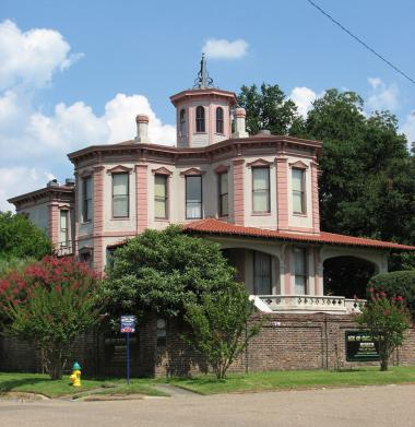 "Grant Recipient: Historic Preservation, Texarkana Museums Systems, Texarkana, TX $10,000 won in a poker game in 1884 allowed James Daughon to build this intriguing Italianate Victorian house in the shape of a club with three octagonal wings and a rectangular wing.  The ""Ace of Clubs"" home is considered one of the most unique in the country."