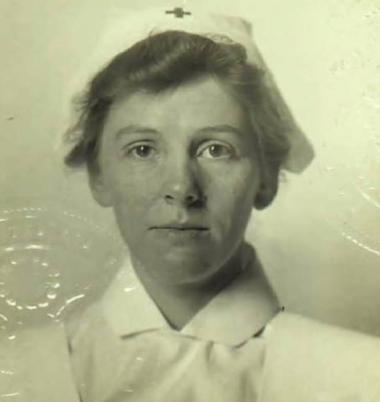 This is the 1917 passport photo of Edward Buncombe Chapter member Anne Penland. Anne Penland of Asheville, NC, was the first graduate of the nurse anesthetist school at Columbia Presbyterian Hospital in New York in 1914, volunteered through the Red Cross to serve in WWI, and sailed for London on May 14, 1917, on the St. Louis, with a group of about 65 doctors, nurses, anesthetists and orderlies from Columbia Presbyterian. She became the first nurse anesthetist to serve on the front lines in France and was